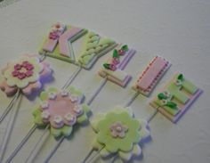 Sugarpaste letter picks can use to add child's name to top of cake.