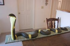 "This was my son's 5th birthday cake.  He loves King Cobras, so for his birthday he wanted a cobra cake.  It was lots of planning and a lot of work.  He LOVED his cake - so all the time and effort was well worth it.  The snake was 9'9"" long when we measured all the curves."