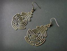 "Earrings | Olga Bulgakova.  ""Spiral Labyrinth"" Wrapped and hammered brass"