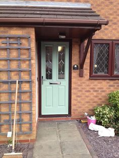 Buy 2 Panel 2 Square Crystal Diamond Composite Front Door in Chartwell Green Online Chartwell Green Front Door, Tudor House, House 2, Front Porch Columns, Yellow Front Doors, Composite Front Door, External Doors, House Front Door, House Extensions