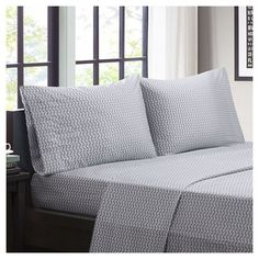 """This Chevron Splendor Printed Sheet Set adds a fun and vibrant pop of color to your room. This super soft sheet set adds comfort and style and is machine washable for easy care. The fitted sheet fits up to a 14"""" mattress."""