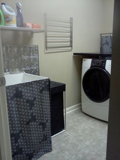 """""""best"""" full view of finished area.  IKEA shelf, IKEA stainless drying rack, IKEA hamper.  Laundry room is SO much nicer and easier to work directly in for sorting/washing/folding."""