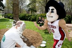 The Quaker mascot gets in on the pie action for Guilford College Philanthropy Day 2012.