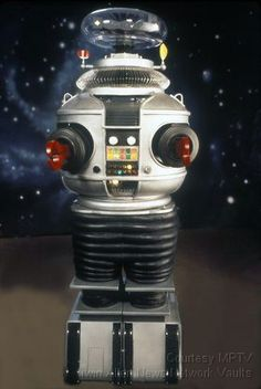 "Robot B-9(his name) on ""Lost in Space"" 1960s show. He was my top fave character on there! and yes affirmative Will Robinson Too! :)"