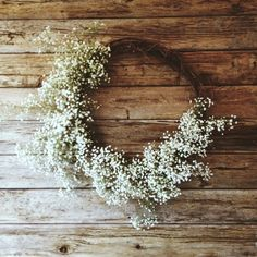 I actually really like this idea. Simple, rustic. Doesn't have to be babies breath, but maybe we could try using other flowers or even feathers to re-create these wreath type things.