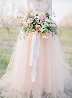 romantic bouquets - photo by Katie McGihon Photography http://ruffledblog.com/spring-almond-orchard-wedding-inspiration