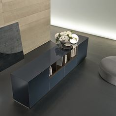 sideboard Self in blu notte glossy lacquered glass, open modules and dividers in mat caffè lacquered.