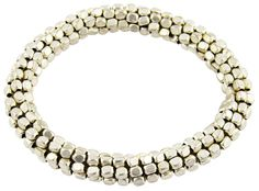 SANDRA: The key to exotic jewelry was exhibited by the simple artwork of this handmade bracelet. Available in silver-tone & gold-tone.