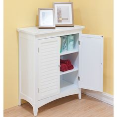 Keep clutter out of sight and your room looking nice with this double-door floor cabinet in classic white. Its two interior shelves are adjustable to meet your needs. The arched, decorative skirt design and shaker legs give this piece added elegance.