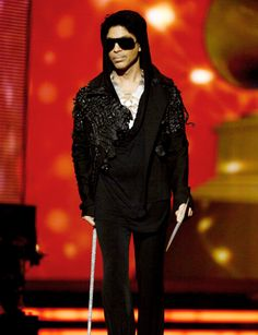 When did Prince start carrying a cane? Is this the birth of Willy Wonka Chic?
