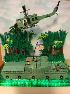 Lego vietnam Bmania style huey modified and my own design atc landing craft Dedicated to the men & woman who served in vietnam. Legos, Lego Bed, Lego Words, Lego Helicopter, Lego Soldiers, Army Men Toys, Lego Kits, Micro Lego, Amazing Lego Creations