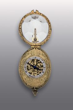 PENDANT OVAL WATCH Isaac Forfait I, Sedan, ca. 1600 Bronze, gilt casing: silver, parcel gilt, engraved, pierced lid: cut rock crystal spring with gut line on fusee hands: blued steel height 6.4 cm, width 3.4 cm, thickness 2.6 cm Inv. 1982.1061.