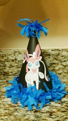 It's never been easier to create your own personalized party hats. We used plain party hats and added colorful tissue paper fringe and our favorite Pokémon to make it our own. Photo and blog at eversosweetparty.wordpress.com