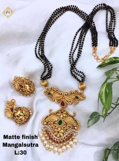 Indian Mangalsutra, Earrings Jewelry Set - Indian Jewelry, Indian Wedding Jewelry, Black Beads Jewellery Earrings, Bridal Jewellery Color : Gold/Silver Material : Metal Sale For : Piece) Collection : Antique Set of Necklace & Earrings Indian Wedding Jewelry, Indian Jewelry, Bridal Jewelry, Beaded Jewelry, Jewellery Earrings, Gold Jewelry, Diamond Jewellery, Women Jewelry, Pearl Jewelry