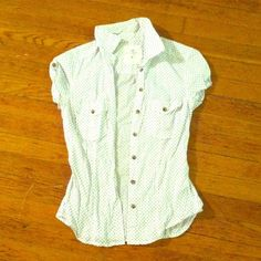 H&M polka dot button down blouse H&M white and navy polka dotted button down blouse. Buttoned and capped sleeves with a fitted body. Fits a small or extra small best. Nearly new condition! Only worn a couple of times. H&M Tops Button Down Shirts