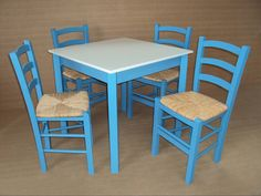 Hand made chairs and tables, traditional of a Greek tavern, painted in blue and white, the colours synonymous with Greece.