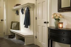 good use of a bench, shoe storage underneath and a shelf above plus coat hooks!