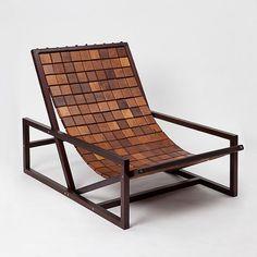 Silla imitando un #puzzle, a base de cuadrados de madera.