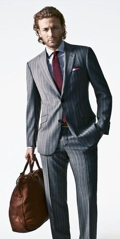 2012 Suits for Men - The New Rules of Suits - Esquire: hem of jacket should be level with knuckles. Fall 2012 Trends: burgundy, pinstripes (tie by Calvin Klein)