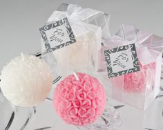 """These popular Rose ball candle wedding favors are made up of tiny rose buds and are available in dusty pink or pearl white. Each rose ball candle favor is presented in a clear gift box. These candles have a burn time of 4 hours.Size: 2 inches in diameter (measures 2 1/4"""" x 2 1/4"""" x 2 1/2"""")Details: The gift box is complete with a sheer white organza ribbon and a blank thank you tag."""
