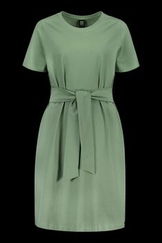 The super-popular T-shirt Dress from Kaiko Clothing now available in the fresh earthy light green color of Sage. The laid-back soft organic cotton T-shirt Dress comes with ribbons at the waist that you can tie either in the back or front. The hem is about knee-length. Outfit ideas for women over 40 casual. #kaikoclothing Ethical Fashion Brands, Organic Cotton T Shirts, Cotton Style, Belted Dress, Clothing Company, The Fresh, Sustainable Fashion, Ribbons, Earthy