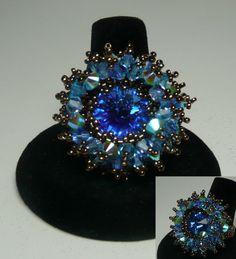 Crystal Burst Sapphire  Design by Laura McCabe Swarovski Sapphire Rivoli with Light Sapphire, Sapphire, Aquamarine and Turquoise AB2X bicones and miyuki beads