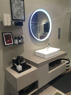19-AD-Round-led-mirror-and-shelves-for-storage-in-bathroom
