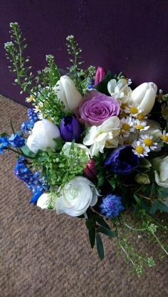 Spring bridal hand tied bouquet of tulips, narcissus, anemones and ranunculas.