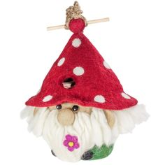 Felt Birdhouse - Garden Gnome - Wild Woolies - Fair Trade - #thisbluesea #fairtrade #shopfairtrade  This hand-felted wool birdhouse is made of sustainably harvested, naturally water repellent wool. Surface moisture from dew, rain or snow quickly dries in the open air. Wool is also naturally dirt and mold resistant. The 1.25 inch hole can be enlarged to 1.5 inches to appeal to larger birds. Measures 11 inches tall by 10 inches wide.  Meet the Artisans  Metal Artisan in Haiti  Walking into the…