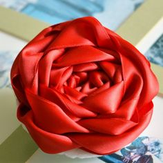 Make an extra large ribbon rose. Perfect for brooches, throw pillows, and other accessories