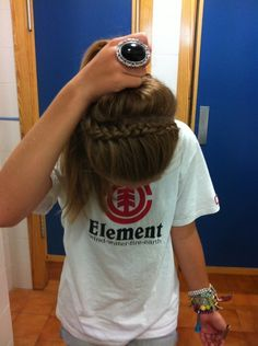 love and super easy!start on whatever side of your head and do an inside outside french braid but only bring the hair on the one side into it.. wear it as a headband or throw it all up :)