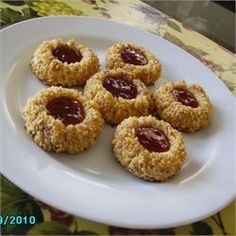 Thumbprint Cookies ... I made these using crushed almonds and left over homemade cranberry sauce.  I had to up the baking time a few minutes after filling them.  Very good!