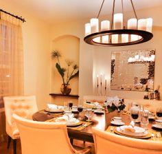 Modern candelabra fixture over dining room table