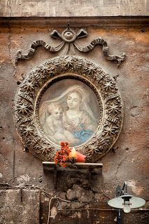 A shrine to the Madonna in restaurant, Campo dei Fiori, Rome, Italy.  Shrines to the Virgin are found all over the city -- hotels, houses, shops, boats, bars -- where she is regarded as a protector.  by Capture Italy
