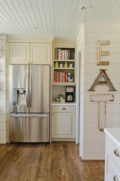 my exact fridge set up. love the cabinets & shelves beside.