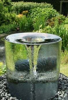 The stunning Volute water feature by Tills Innovations. A vortex being captured and displayed in clarity and detail. What appears to be a solid piece of glass with a spinning vortex. A mesmerising water feature. #Waterfeatures