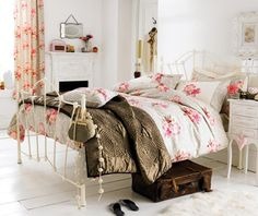 Not crazy about the brown comforter, I would have loved a bright red throw!