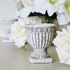 Stone urn filled with a candle from blissandbloom.co.uk