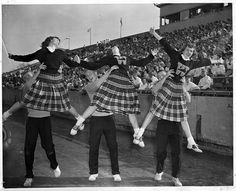 The plaid skirts and megaphones on their initial sweaters are fabulous! #vintage #school #cheerleader #uniform #teenagers #students #pep #saddle_shoes #1950s