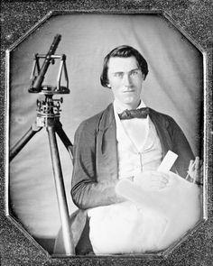 Occupational portrait of an unidentified surveyor with a transit on a tripod and holding dividers and a map. sixth plate daguerreotype, ca. 1840-1860.