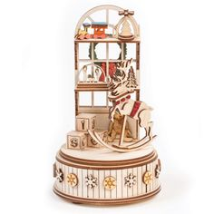 The Enchanting Music Box They'll Watch Over and Over     Eyes will light up with amazement as Santa's workshop (along with all its toys) rotate to the melody of Santa Claus is Coming to Town. Nostalgic and handmade with gorgeous detail, we couldn't pass it by. It may be priced higher, but it has everything folks ask us for: USA made, no plastic and heirloom quality.     Sure to be part of your family's Christmas tradition   Just turn the base of the workshop for the music and movement to…