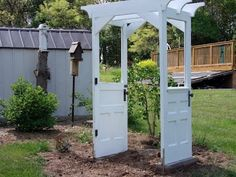 Creative use of a couple of old doors.  Almost instant pergola.  Fantastic idea!
