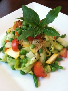 Raw Zucchini 'pasta' with raw pesto sauce and garden vegetables.
