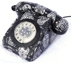 Special Edition fully restored and working vintage 746 telephone. Hand finished in Sugar Skulls fabric with durable varnish overlay, shimmer and Swarovski crystals. Also available from www.lovekittypink.com Bespoke designs and styles can be made to order.