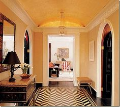 Black interior doors and that amazing herringbone floor. Stunning.