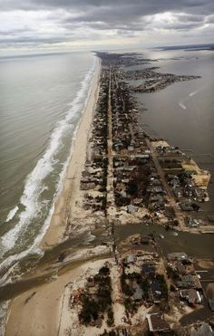 MANTOLOKING, NJ - OCTOBER 31: Homes sit in ruin after Superstorm Sandy on October 31, 2012 in Mantoloking, New Jersey. At least 50 people were reportedly killed in the U.S. by Sandy with New Jersey suffering massive damage and power outages. Photo: Mario Tama, Getty Images / 2012 Getty Images