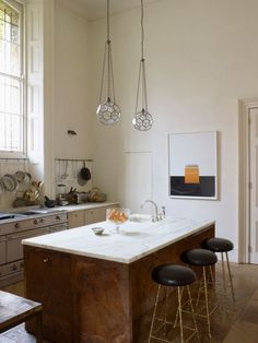 I love the hanging lights in this kitchen