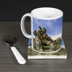 "11oz Mug - Joshua Tree National Park ""Joshua Tree Valley"". This panorama image of a valley I found on a hike deep into Joshua Tree National Park. Every so often I return to this serene place to take in the majesty of this wonderful place, Joshua Tree. The image is printed on a 11oz ceramic mug with lettering ""Joshua Tree National Park"" near the handle. ,br> This mug is dishwasher safe and will serve both hot and cold drinks. Pictured with both a matching optional glass or Italian marble..."