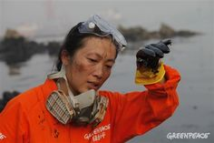 We're celebrating three badass women in China who are marked by their gutsiness, passion and impact they've made on the environmental movement in China. This is Zhong Yu, our actions co-ordinator pictured at the #Dalian oil spill. © Greenpeace