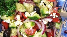A light salad with a big taste. Olives, tomatoes, red onion, and cucumbers are dressed with olive oil and a splash of lemon juice and finished with crumbled feta cheese.